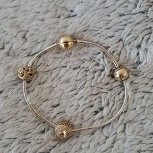 Pandora essence 14k gold bracelet & charm set